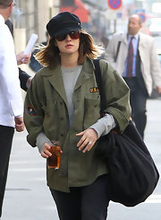 Drew Barrymore went for a grungy look at yoga in a military jacket and cap.