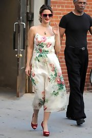 Drew looked lovely in a floral-printed dress with peep toe pumps and matching red lips.