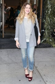 For a pop of color to her outfit, Drew Barrymore wore a pair of red suede platform sandals.