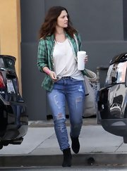Casual was the name of the game when Drew Barrymore stepped out in an unbuttoned green plaid shirt and plain white tee.