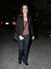 Barbara Hershey went to dinner carrying a black nylon crossbody bag.