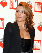 Sophia Thomalla showed off her side swept curls at a charity event in Berlin. A bronzed glow completed her look.
