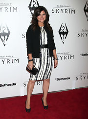 Black platform pumps with metal embellishments completed Tiffani Thiessen's classy ensemble.
