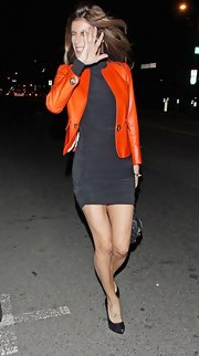 Elisabetta Canalis spiced up her slinky gray mini dress with a bold orange jacket.