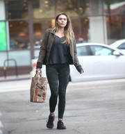 Elizabeth Olsen dressed down in a gray henley shirt for a day of shopping.