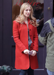 Ella Rae Peck brightened up her on set style with a retro red coat with oversize pockets.