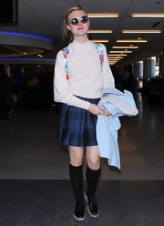 Elle played up the prep school angle in a pair of knee-high socks.