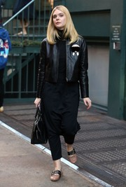 Elle Fanning looked majorly cool in her black Fendi Karlito leather jacket while out and about in New York City.