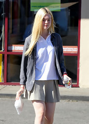 Elle Fanning channeled preppy school-girl style in an unbuttoned oxford layered over a white polo.