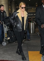 Ellie Goulding bundles up in a black leather jacket while leaving LAX