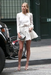 Elsa Hosk added extra shimmer with a quilted silver bag.