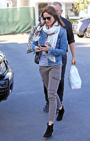 Emily topped off her daytime look with a classic denim jacket and scarf.