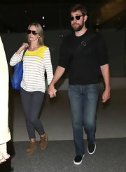 Emily Blunt's travel look was casual and cool with this white and yellow striped long-sleeve tee.