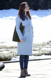 Emily Blunt shot scenes for 'The Girl on the Train' wearing a stylish pale-blue wool coat with layered lapels.