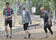 Emma Stone went for a walk with her BF Andrew Garfield in sporty Nike crosstrainers.