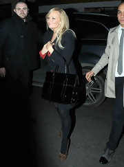 Emma Bunton maintained her simply chic look with a black patent tote.