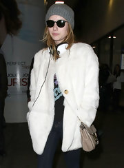 Emma Roberts epitomized LA chic in black quirky sunglasses paired with a beanie and fur coat.