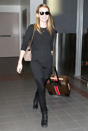 Emma Roberts travels in style with an ultra luxe Louis Vuitton suitcase.