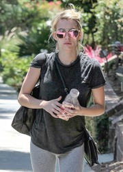Emma Roberts looked cool and cute wearing these pink sunnies by Westward Leaning while out on a stroll.