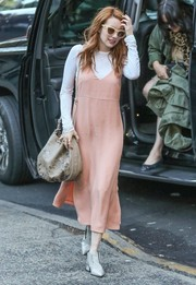 Emma Roberts topped off her ensemble with an embroidered leather hobo bag by Etro.