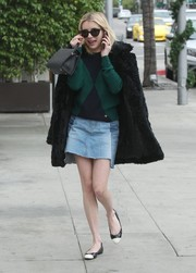 Emma Roberts looked cute in a frayed denim mini skirt teamed with a Christmas-y sweater while shopping in Beverly Hills.