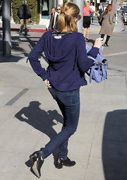 Emma Roberts kept casual in dark jeans and black leather shoes.