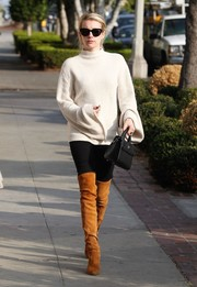 Emma Roberts sealed off her look with camel-colored thigh-high boots by Stuart Weitzman.