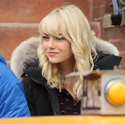 Emma Stone's blonde locks looked flawless with these bouncy curls and side swept bangs.