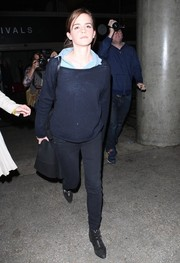 Emma Watson was spotted at LAX dressed down in a navy boatneck sweater and black skinny jeans.