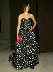 Emmy Rossum's magenta satin clutch contrasted beautifully with her monochrome gown.