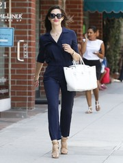 Emmy Rossum looked cool and chic in a navy Diane von Furstenberg jumpsuit while out shopping.