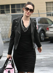 Emmy Rossum donned oversize tortoiseshell shades with a leather jacket and statement necklace.