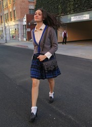 Emmy Rossum could pass off as a schoolgirl in her gray cardigan and white button-down combo.
