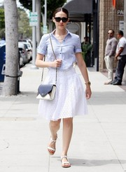 Emmy Rossum kept it breezy in a short-sleeve blue button-down while out in Beverly Hills.