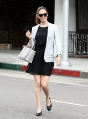 Emmy Rossum stepped out in Beverly Hills looking casual-chic in a white blazer layered over a little black dress.