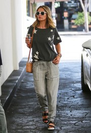 A pair of Dr. Scholls slides add comfort and style to Rebecca Gayheart's outfit.