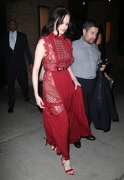 Eva Green cut an elegant figure in a red lace-panel gown by Elie Saab while out in New York City.