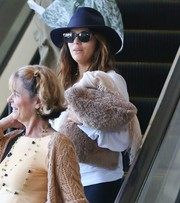 A bare-faced Eva Longoria was almost unrecognizable in her blue fedora and wayfarer sunglasses as she arrived at LAX.