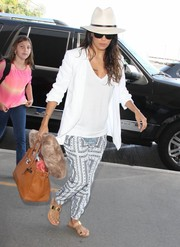 Chain-embellished sandals by Casadei sealed off Eva Longoria's travel outfit.