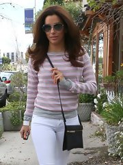 Eva Longoria looked casual and cool while out in Hollywood where she wore a grey and pink striped sweater.