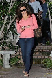 Eva Longoria kept her look casual and comfy with this pink V-neck sweater.