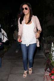 For her footwear, Eva Longoria chose trendy nude cutout booties by Aquazurra.