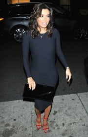 Eva Longoria styled her LBD with chic red wave-strap sandals by Prada.