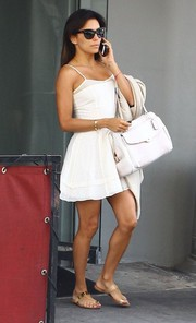 Eva Longoria matched her dress with a white Coach leather tote.
