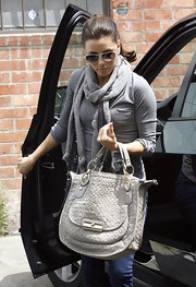 Eva Longoria ran errands in West Hollywood toting a Kristen woven leather sage satchel.