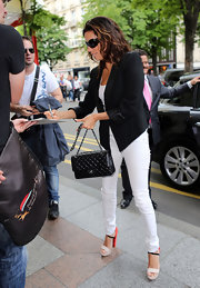 Eva Longoria looked chic in a pair of colorful heels while graciously signing autographs on a street in Paris.