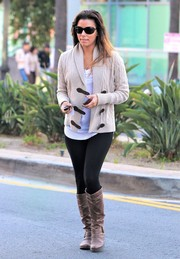 Eva Longoria completed her look with brown knee-high boots.