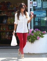 Eva Longoria went on a coffee run wearing a basic white button-down and red skinny pants.