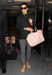 Eva Longoria teamed her jacket with black-and-white striped leggings.