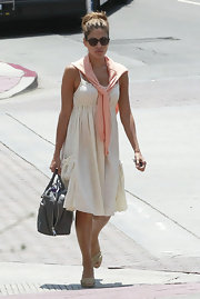 Eva Mendes showed off her summery style in this gauzy ivory dress.